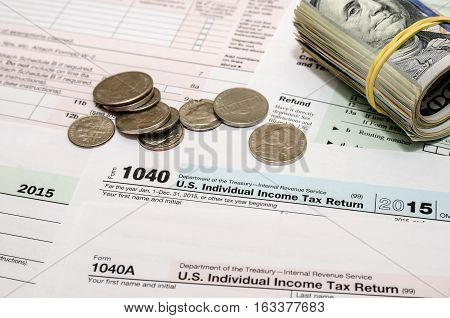 1040 tax form with a us coin