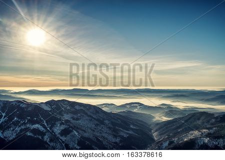 Inversion in mountains and colorful sky in Low Tatras Slovakia