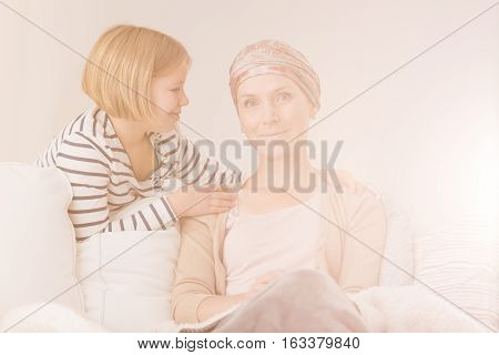 Child Supporting Her Ill Mother