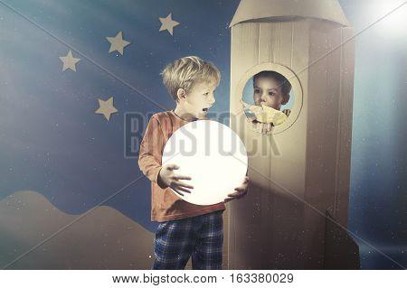 Boy Showing The Shining Ball