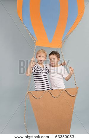 Brothers during fascinating voyage in air balloon