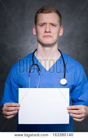 Depressed Man With Piece Of Paper