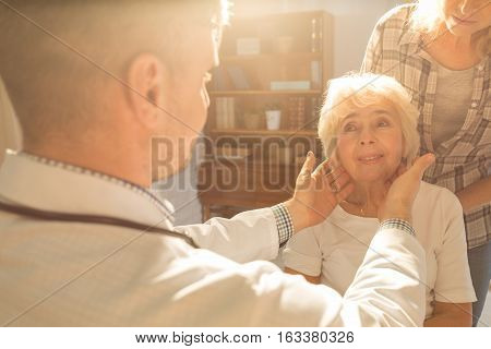 Physician visiting senior patient at her home