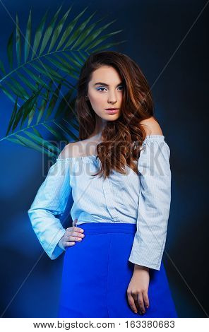 fashion women with blue backlight background in studio