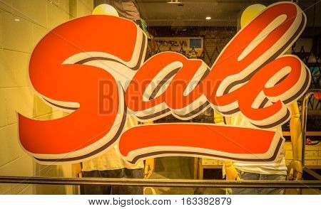the symbolic sign which shown the season of shopping and sales, has specify on the window display in front of the model