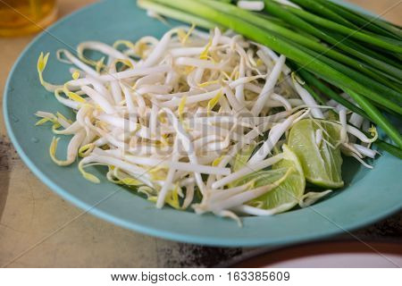 Close up of bean Sprouts and lemon eating with Pad Thai