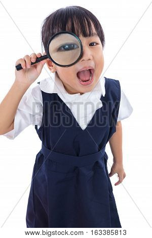 Happy Asian Chinese Little Primary School Girl Holding Magnifying Glass