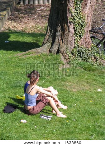 Two Girls Chatting In A Park.