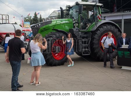 Ukraine Kiev - June 10 2016: Visitors near the exhibits International agro-industrial exhibition