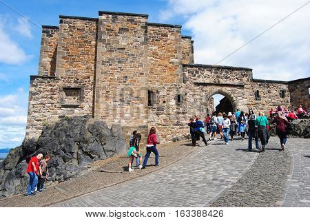 Edinburgh, United Kingdom - June 19, 2014. Foogs gate is the main entrance to the citadel of the Edinburgh castle. View of the gate with people.