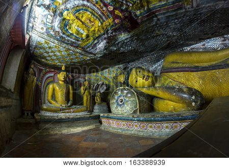 DAMBULLA SRI LANKA - CIRCA NOVEMBER 2011: Statue of reclining golden Buddha sleeping in the cave temple