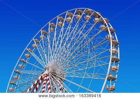 circular big ferris wheel on blue sky background
