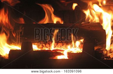 Woods burning in hot fire chimney (close up)