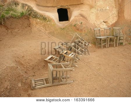 Chairs in front of a cave in Capadocia, Turkey.