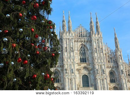 Huge Christmas Tree With Red Balls And Silver And The Facade Of