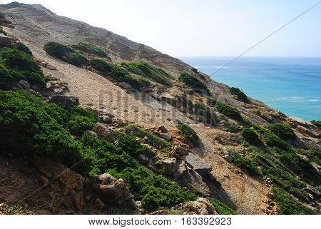 Dinosaur footprints on the limestone cliffs north of Cabo Espichel in Portugal.