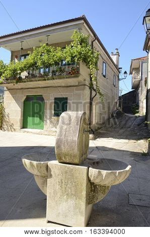 Fountain in square in Combarro a village of the province of Pontevedra in the Galicia region of Spain.