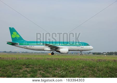 Amsterdam The Netherlands - August 10 2015: EI-DEK Aer Lingus Airbus A320-214 taxing on the Polderbaan runway to the main terminal of Amsterdam Schiphol Airport