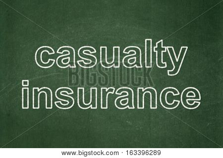 Insurance concept: text Casualty Insurance on Green chalkboard background