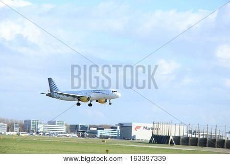Amsterdam The Netherlands march 31 2015: EC-HQI Vueling Airbus A320-214 approaching on runway 09-27 Buitenveldert