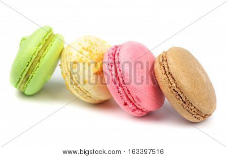 A french sweet delicacy macaroons variety closeup. Macaroons on white background