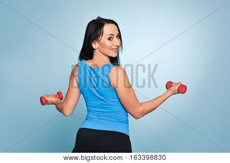 Fitness Woman Working Out With Dumbbells.