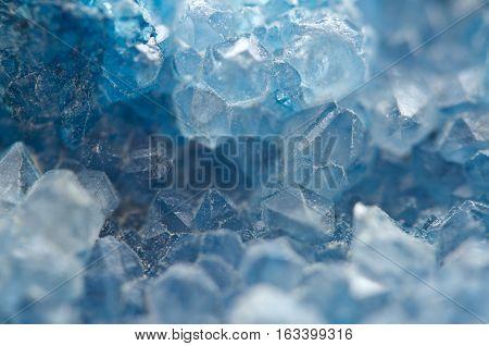 Agate is a cryptocrystalline variety of crystal quartz. Macro Texture aquamarine crystals.
