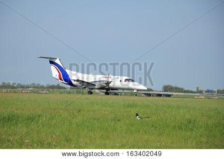 Amsterdam the Netherlands - May11th 2015:EC-IMX Swiftair Embraer EMB-120FC Brasilia on the Polderbaan runway of Amsterdam Schiphol Airport.