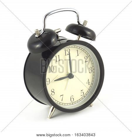 Alarm clock in black case shows 9 hours, photo isolated on white close up