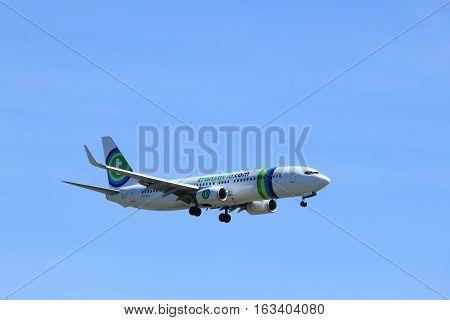 Amsterdam the Netherlands - May 5th 2016: PH-HSJ Transavia Boeing 737 approaching Schiphol Polderbaan runway arriving from Faro Portugal