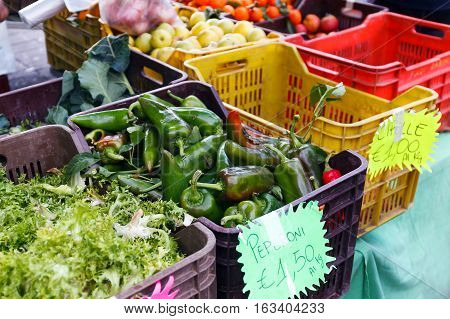overflowing crates of fruit and vegetables at the local market
