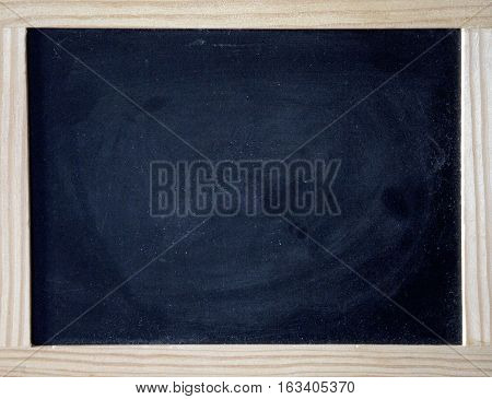 a black chalkboard with brown wooden frame