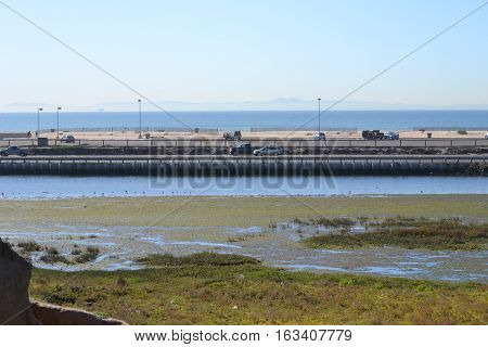 Scenic view of Bolsa Chica Ecological reserve and Bolsa Chica State Beach. Catalina island can also be seen on the horizon