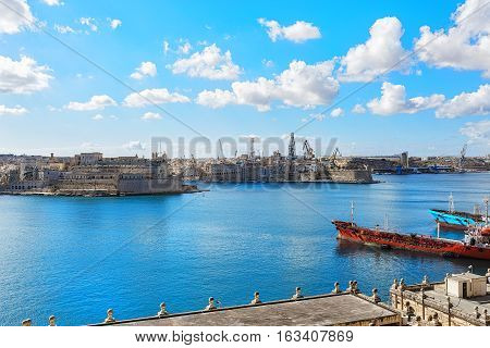 Malta city view with houses and blue sea