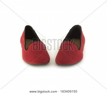 Two beautiful crimson female shoes without heels standing inside the toe isolated on white closeup