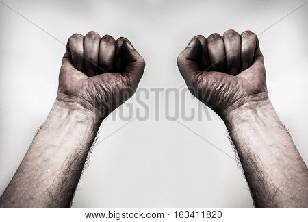 dirty handsdirty fist , isolated on the grey background
