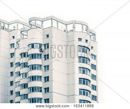 the white apartment house on the white