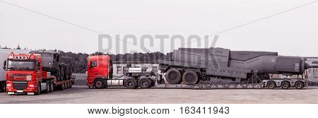 the super-heavy linehaulers laden with big machines