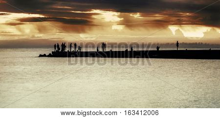 landscape with the sea pier at sunset