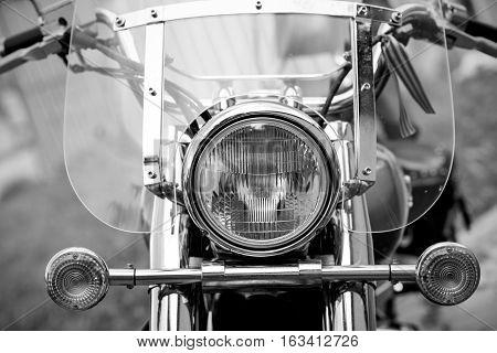 Close up shot of a motorcycle headlight lamp.