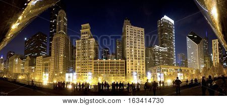 Silhouettes of people in front of Michigan Avenue buildings.