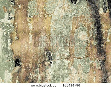 Muro con grietas y manchas de humedad