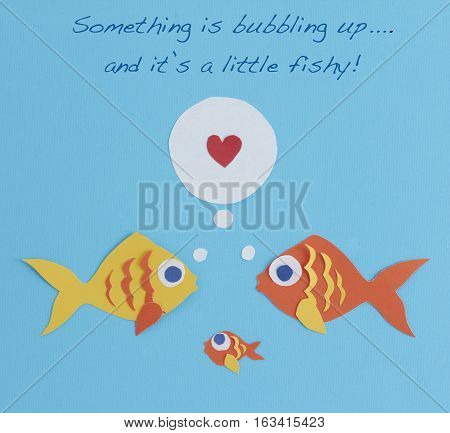 Paper fish family birth or pregnancy announcement