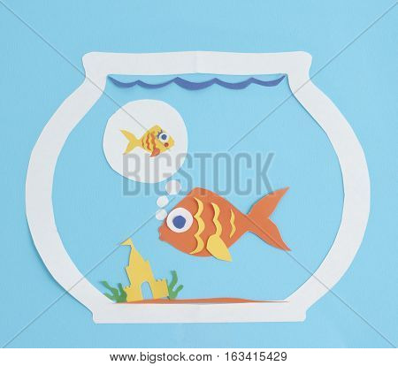Paper fish dreaming of a friend or partner to join them in the fishbowl