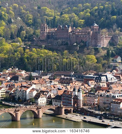 HEIDELBERG, GERMANY - MAR 29, 2014: Castle of Heidelberg and a bridge Alte Brucke in Spring, Southern Germany.