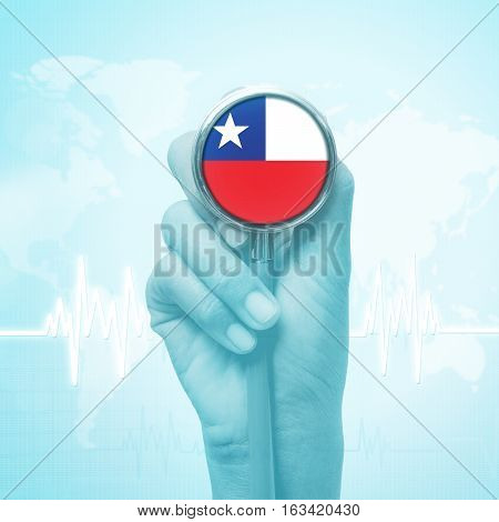 doctor hand holding stethoscope with Chile flag.