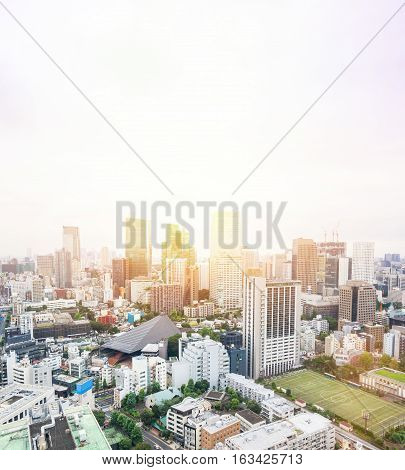Business and culture concept - panoramic modern city skyline bird eye aerial view from tokyo tower under dramatic sunrise and morning blue sky in Tokyo Japan