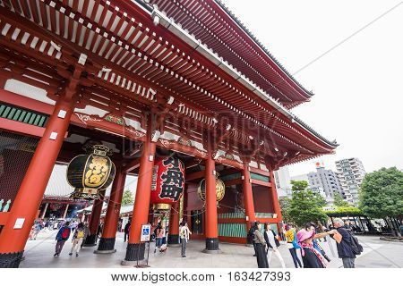 Toyko Japan - 13 October 2016: Tourists walk on Senso ji shrine red gate. the history culture Heritage in Asakusa district Tokyo Japan at 13 October 2016