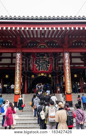 Toyko Japan - 13 October : Tourists walk on Senso ji shrine red gate. the history culture Heritage in Asakusa district Tokyo Japan at 13 October 2016