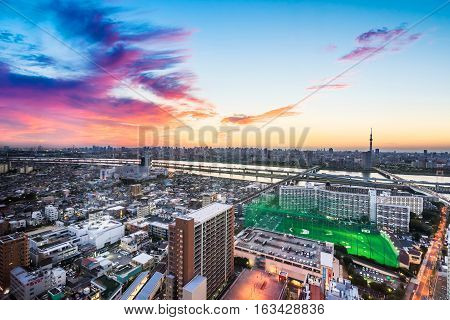 Business and culture concept - panoramic modern city skyline bird eye aerial view with Mountain Fuji and tokyo skytree under dramatic sunset glow and beautiful cloudy sky in Tokyo Japan